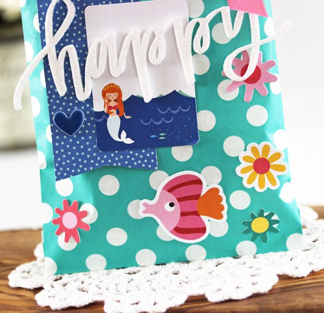 Happy Gift Bag (detail) by Laurie Schmidlin